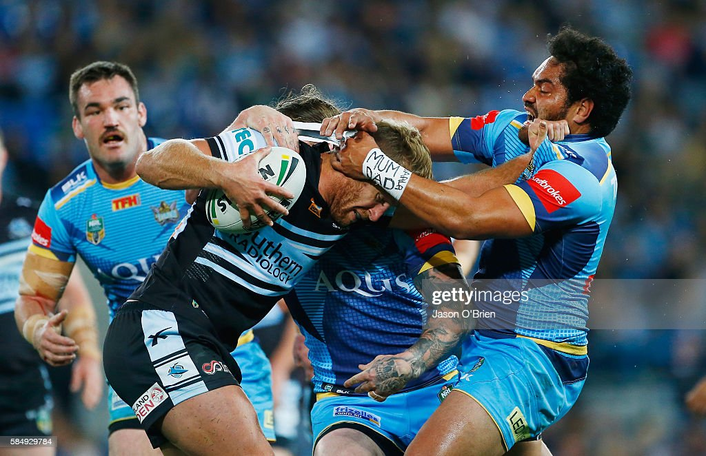 Shark's Matt Prior is tackled by the Titans defence during the round 21 NRL match between the Gold Coast Titans and the Cronulla Sharks at Cbus Super Stadium on August 1, 2016 in Gold Coast, Australia.