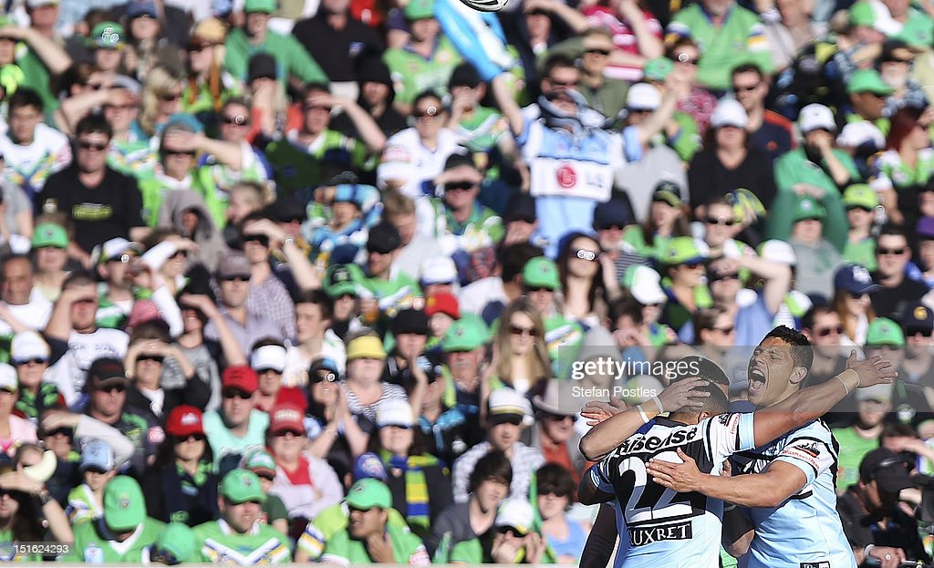 Sharks players celebrate after Ricky Leutele of the Sharks scored a try during the Second NRL Elimination Final match between the Canberra Raiders and the Cronulla Sharks at Canberra Stadium on September 9, 2012 in Canberra, Australia.