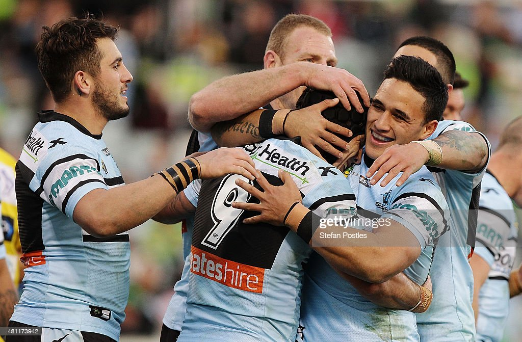 Sharks players celebrate during the round 19 NRL match between the Canberra Raiders and the Cronulla Sharks at GIO Stadium on July 18, 2015 in Canberra, Australia.