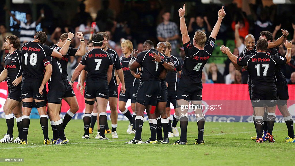 Sharks players celebrate during the Super Rugby round eight match between the Sharks and Crusaders from Kings Park on April 05, 2013 in Durban, South Africa.