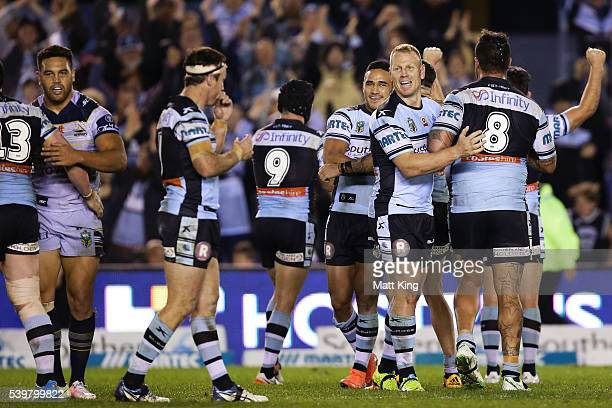 Sharks players celebrate their win during the round 14 NRL match between the Cronulla Sharks and the North Queensland Cowboys at Southern Cross Group...