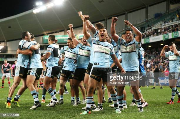 Sharks players celebrate victory at the end of the round 17 NRL match between the Sydney Roosters and the Cronulla Sharks at Allianz Stadium on July...