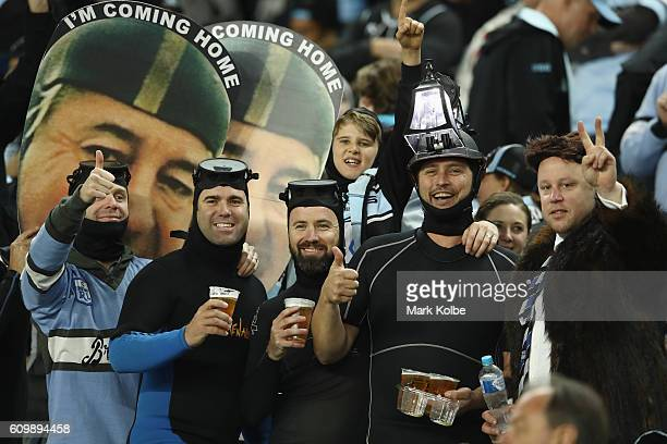 Sharks supporters dressed as Harold Holt are seen in the corwd during the NRL Preliminary Final match between the Cronulla Sharks and the North...