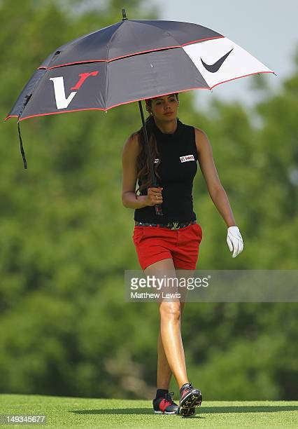 Sharmila Nicollet of India shelters from the heat during day two of the Evian Masters at the Evian Masters Golf Club on July 27 2012 in EvianlesBains...