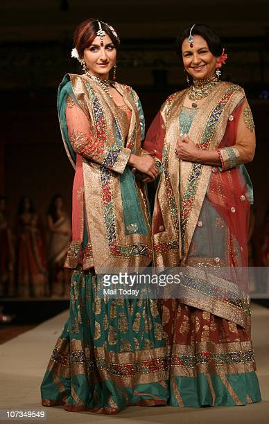 Sharmila Tagore and her daughter Soha Ali Khan walk the ramp for designer Ritu Kumar at a show presented by American Express and the Taj Group of...