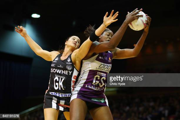 Sharni Layton of the Magpies and Romelda Aiken of the Firebirds compete for the ball during the round two Super Netball match between the Queensland...