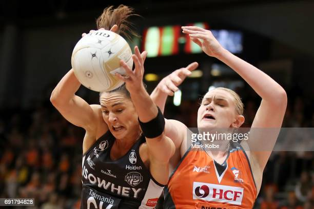 Sharni Layton of the Magpies wins the ball over Kristina Brice of the Giants during the Super Netball Major Semi Final match between the Giants and...
