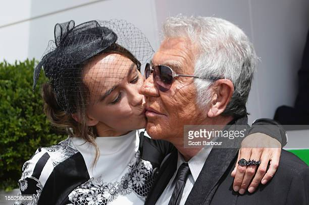 Sharni Vinson kisses Roberto Cavalli as they attend the Lavazza marquee on Derby Day at Flemington Racecourse on November 3 2012 in Melbourne...