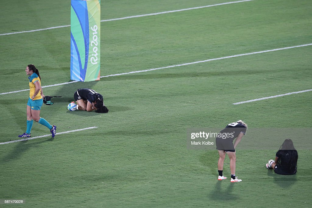Sharni Williams of Australia celebrates victory as Portia Woodman Kelly Brazier and Tyla NathanWong of New Zealand look dejected after the Women's...