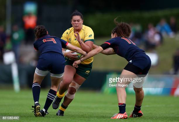 Sharni Williams of Australia is tackled by Yanna Rivoalen and Caroline Drouin of France during the Women's Rugby World Cup 2017 match between France...