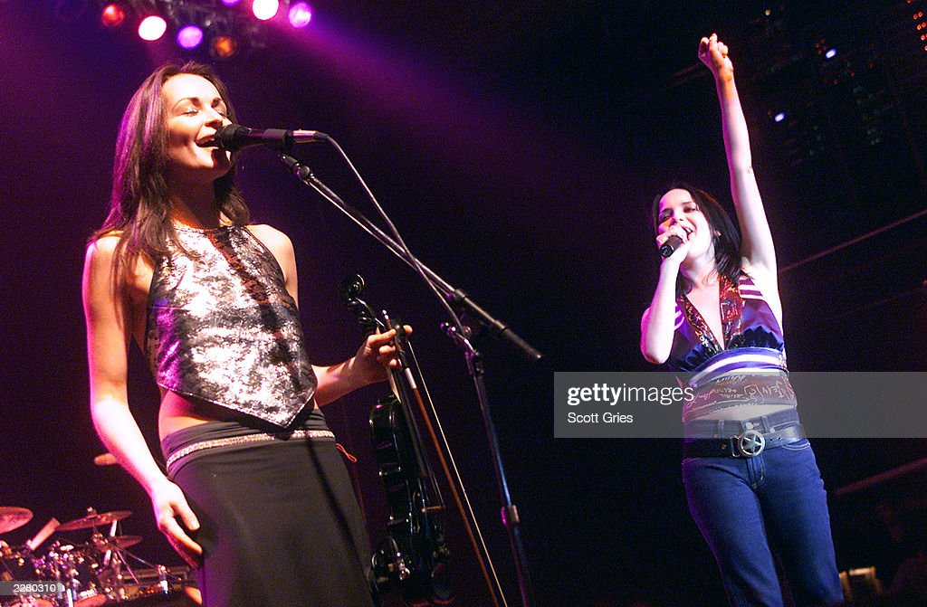 Sharon(on left) and Andrea Corr of The Corrs perform during 'Vogue Takes Miami' at Level in Miami, Florida. 12/6/00 Photo: Scott Gries/ImageDirect