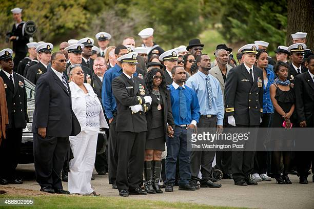 Sharon Blair and dozens of family members attend the memorial service for United States Navy MasteratArms 2nd Class Mark A Mayo at Arlington National...