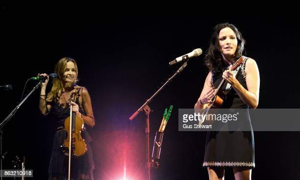 Sharon Corr and Andrea Corr of The Corrs perform on stage at the Royal Albert Hall on October 19 in London England