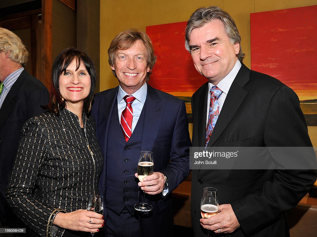 Sharon Harroun Peirce, Nigel Lythgoe and Bob Peirce attend a Golden Globe lunch hosted by BritWeek chairman Bob Peirce honoring Julian Fellowes, Gareth Neame and Michelle Dockery at Four Seasons Hotel Los Angeles at Beverly Hills on January 12, 2013 in Beverly Hills, California.