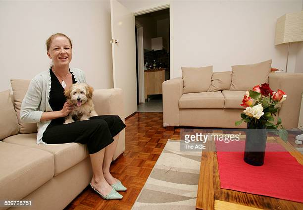 Sharon Keavell at home in StKilda with her puppy 21st Dec 2005 THE AGE DOMAIN Picture by REBECCA HALLAS