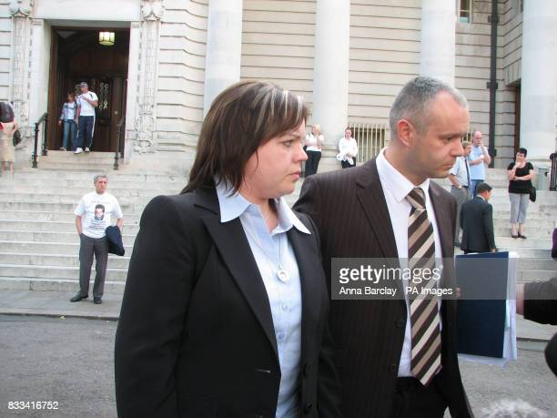 Sharon Mills leaves Cardiff Crown Court with an unidentified man after butcher William John Tudor who supplied schools with meat infected with a...