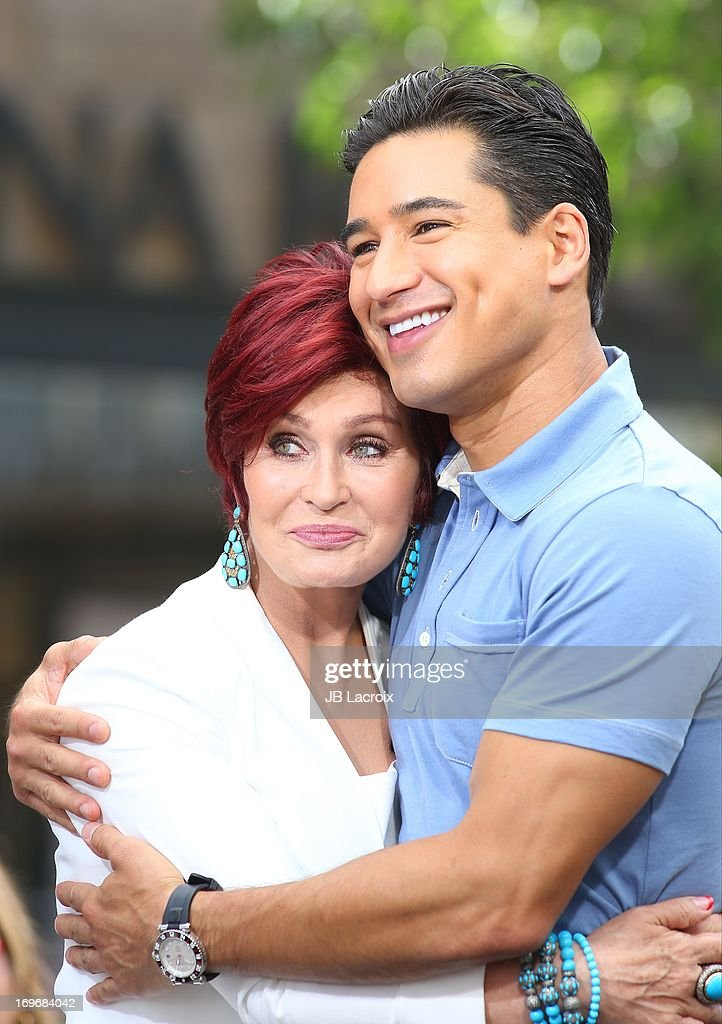 <a gi-track='captionPersonalityLinkClicked' href=/galleries/search?phrase=Sharon+Osbourne&family=editorial&specificpeople=203094 ng-click='$event.stopPropagation()'>Sharon Osbourne</a> and <a gi-track='captionPersonalityLinkClicked' href=/galleries/search?phrase=Mario+Lopez&family=editorial&specificpeople=235992 ng-click='$event.stopPropagation()'>Mario Lopez</a> are seen at The Grove on May 30, 2013 in Los Angeles, California.