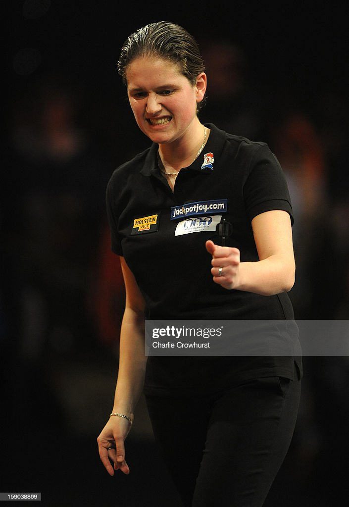 Sharon Prins of The Netherlands celebrates winning her Quarter Final match against Irina Armstrong of Germany on day two of the BDO Lakeside World Professional Darts Championships at Lakeside Country Club on January 06, 2013 in London, England.