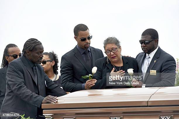 Sharon Risher 2nd from right and Gary Washington left pay their respects at the casket of their mother Ethel Lance before her burial at the AME...