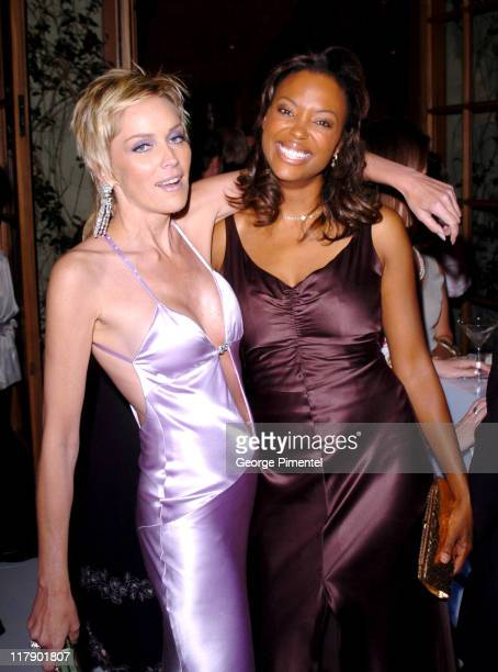 Sharon Stone and Aisha Tyler during The 56th Annual Primetime Emmy Awards Fox After Party Inside at Spago in Beverly Hills California United States