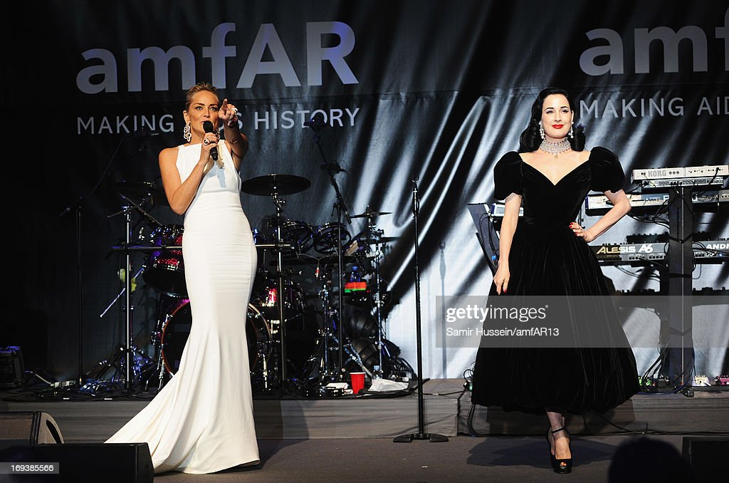 <a gi-track='captionPersonalityLinkClicked' href=/galleries/search?phrase=Sharon+Stone&family=editorial&specificpeople=156409 ng-click='$event.stopPropagation()'>Sharon Stone</a> and Dita von Teese (R) attends amfAR's 20th Annual Cinema Against AIDS during The 66th Annual Cannes Film Festival at Hotel du Cap-Eden-Roc on May 23, 2013 in Cap d'Antibes, France.
