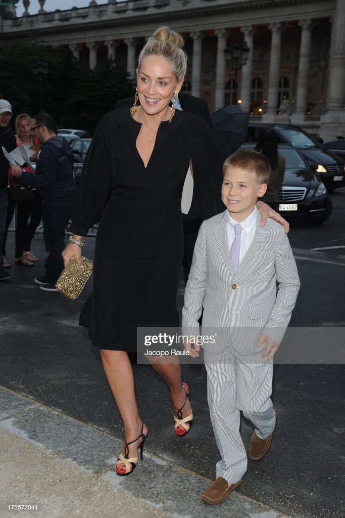 <a gi-track='captionPersonalityLinkClicked' href=/galleries/search?phrase=Sharon+Stone&family=editorial&specificpeople=156409 ng-click='$event.stopPropagation()'>Sharon Stone</a> and her son arrive at 'The Glory Of Water' : Karl Lagerfeld's Exhibition Dinner at Fendi on July 3, 2013 in Paris, France.