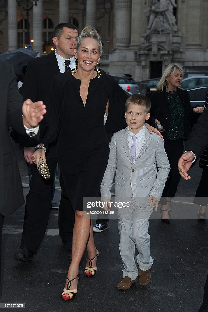 Sharon Stone and her son arrive at 'The Glory Of Water' : Karl Lagerfeld's Exhibition Dinner at Fendi on July 3, 2013 in Paris, France.