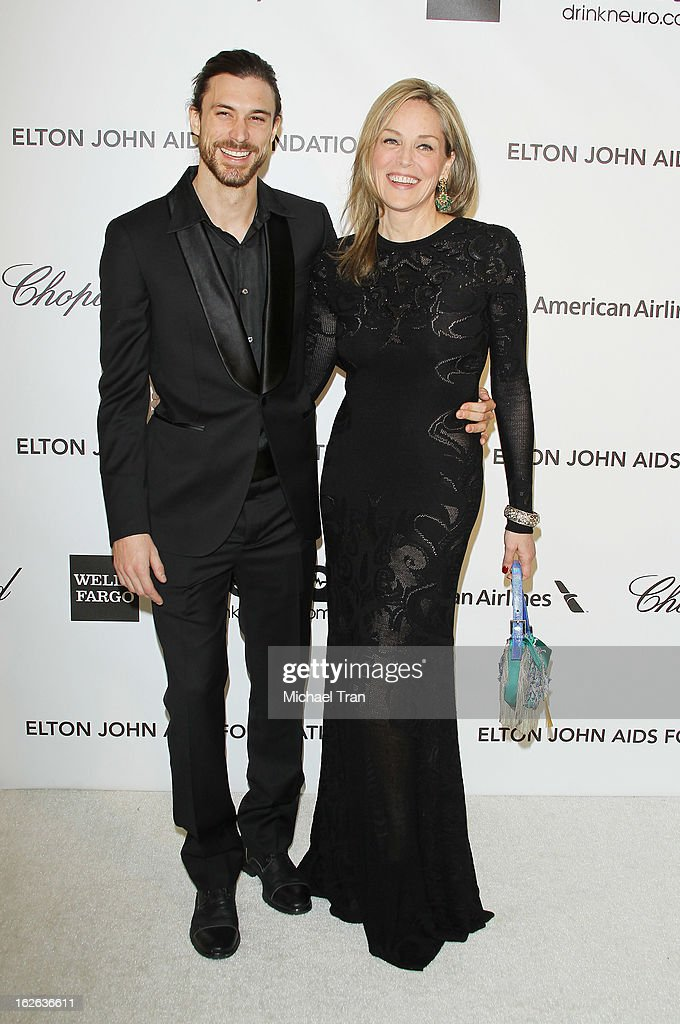 <a gi-track='captionPersonalityLinkClicked' href=/galleries/search?phrase=Sharon+Stone&family=editorial&specificpeople=156409 ng-click='$event.stopPropagation()'>Sharon Stone</a> (R) and Martin Mica arrive at the 21st Annual Elton John AIDS Foundation Academy Awards viewing party held at West Hollywood Park on February 24, 2013 in West Hollywood, California.