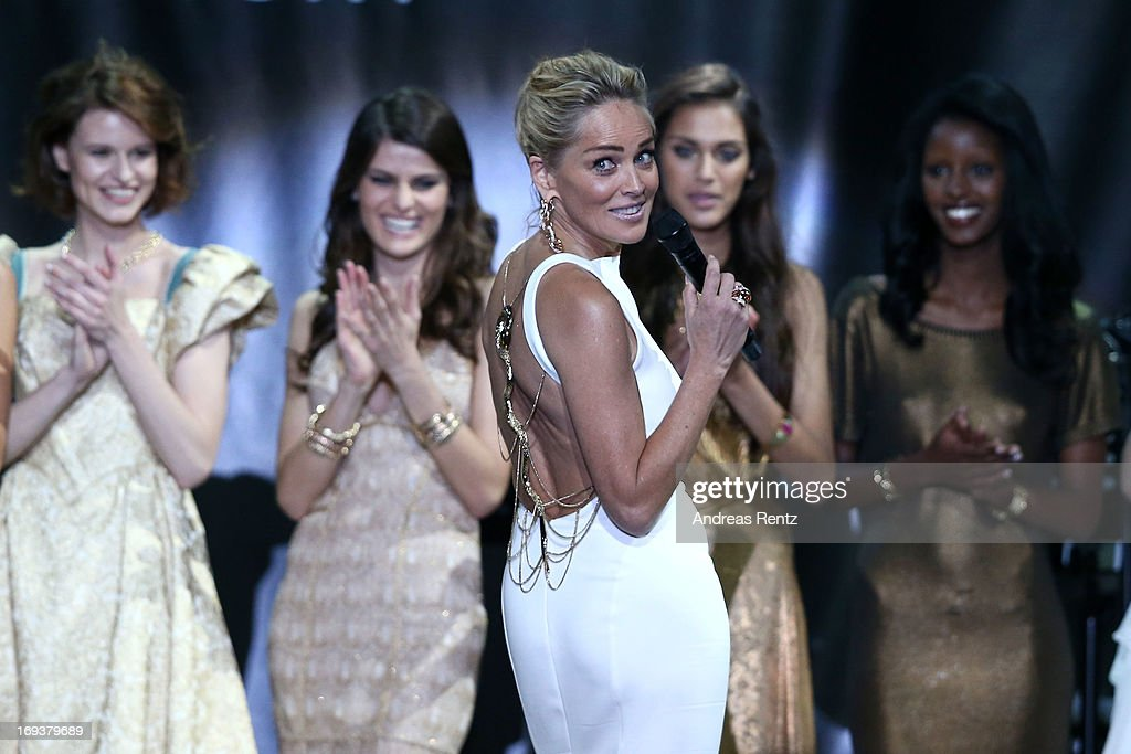 <a gi-track='captionPersonalityLinkClicked' href=/galleries/search?phrase=Sharon+Stone&family=editorial&specificpeople=156409 ng-click='$event.stopPropagation()'>Sharon Stone</a> appears on stage as part of amfAR's 20th Annual Cinema Against AIDS during The 66th Annual Cannes Film Festival at Hotel du Cap-Eden-Roc on May 23, 2013 in Cap d'Antibes, France.
