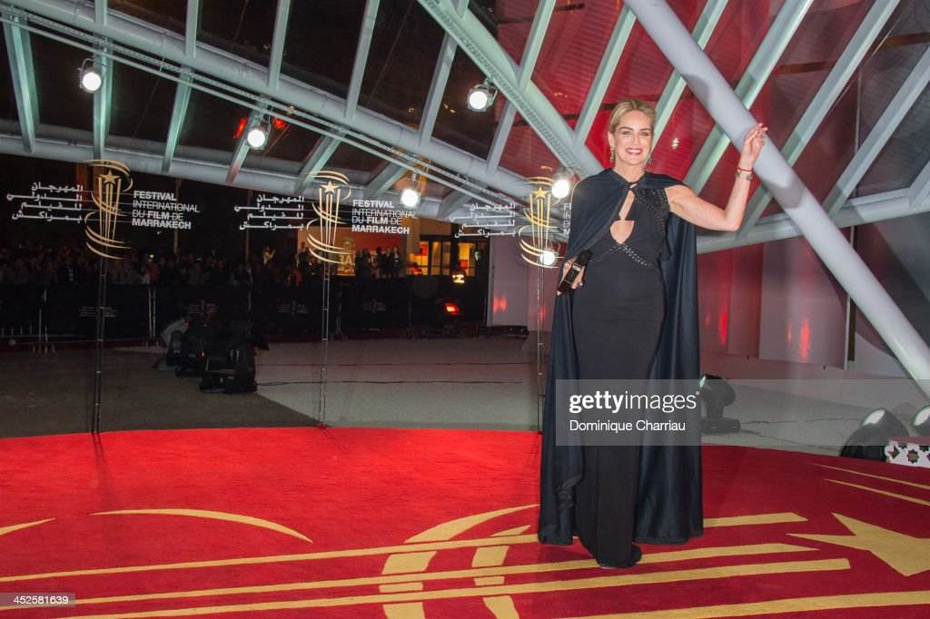 <a gi-track='captionPersonalityLinkClicked' href=/galleries/search?phrase=Sharon+Stone&family=editorial&specificpeople=156409 ng-click='$event.stopPropagation()'>Sharon Stone</a> arrives at the opening ceremony of the 13th Marrakesh International Film Festival on November 29, 2013 in Marrakech, Morocco.