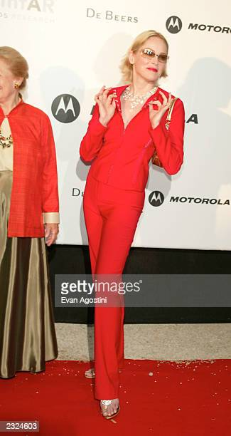 Sharon Stone arriving at amfAr's Cinema against AIDS 2002 benefit gala at Le Moulin de Mougins during the 55th Cannes Film Festival in Cannes France...