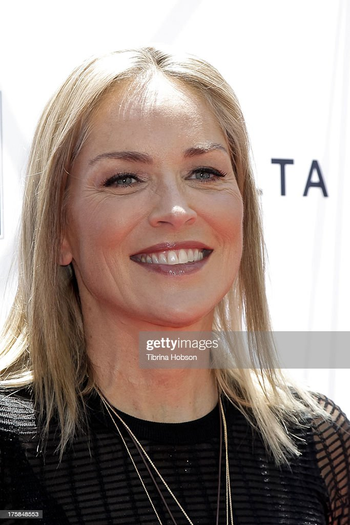 Sharon Stone attends the 4th annual Kiehl's LifeRide for amfAR at The Grove on August 8, 2013 in Los Angeles, California.