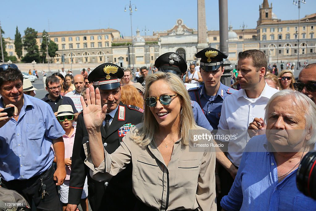 <a gi-track='captionPersonalityLinkClicked' href=/galleries/search?phrase=Sharon+Stone&family=editorial&specificpeople=156409 ng-click='$event.stopPropagation()'>Sharon Stone</a> filming the 'Il Ragazzo Oro' at Piazza Del Popolo on July 18, 2013 in Rome, Italy.
