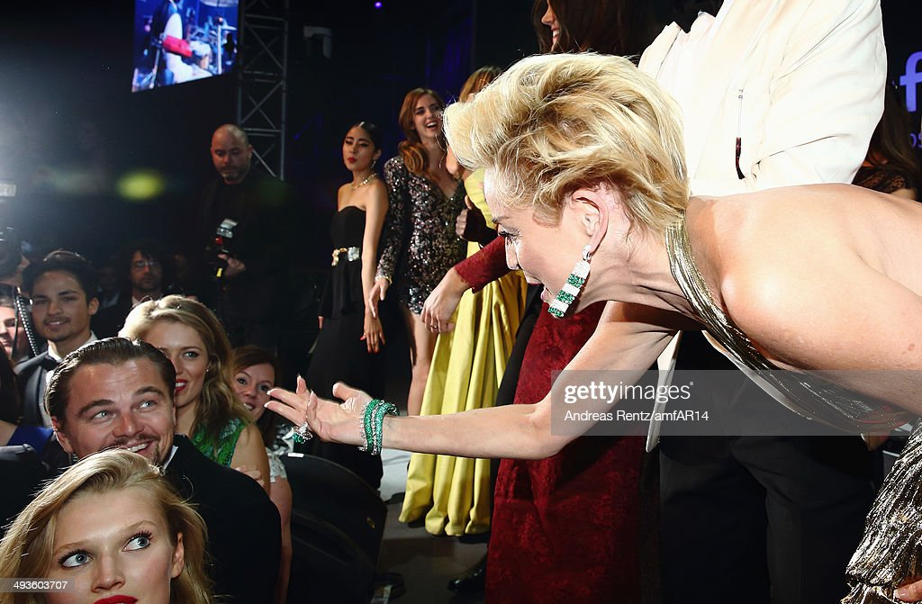 <a gi-track='captionPersonalityLinkClicked' href=/galleries/search?phrase=Sharon+Stone&family=editorial&specificpeople=156409 ng-click='$event.stopPropagation()'>Sharon Stone</a> greets <a gi-track='captionPersonalityLinkClicked' href=/galleries/search?phrase=Leonardo+DiCaprio&family=editorial&specificpeople=201635 ng-click='$event.stopPropagation()'>Leonardo DiCaprio</a> during amfAR's 21st Cinema Against AIDS Gala Presented By WORLDVIEW, BOLD FILMS, And BVLGARI at Hotel du Cap-Eden-Roc on May 22, 2014 in Cap d'Antibes, France.