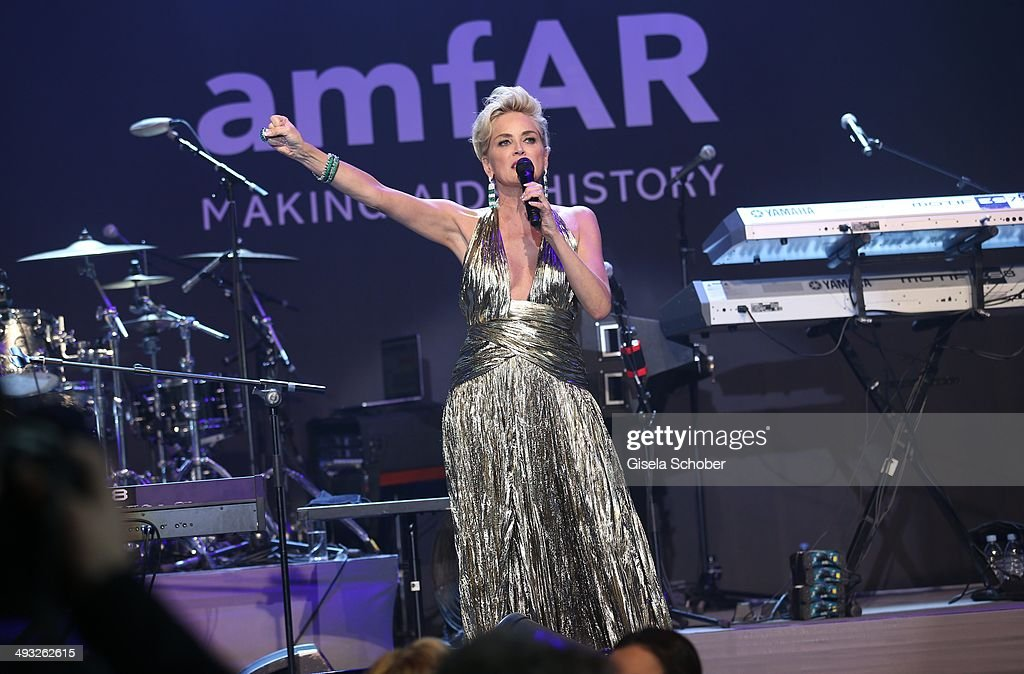 Sharon Stone speaks on stage at amfAR's 21st Cinema Against AIDS Gala Presented By WORLDVIEW, BOLD FILMS and BVLGARI at Hotel du Cap-Eden-Roc on May 22, 2014 in Cap d'Antibes, France.