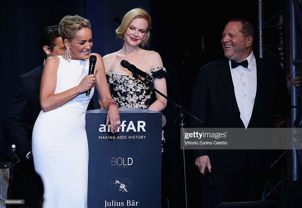 <a gi-track='captionPersonalityLinkClicked' href=/galleries/search?phrase=Sharon+Stone&family=editorial&specificpeople=156409 ng-click='$event.stopPropagation()'>Sharon Stone</a> speaks on stage with <a gi-track='captionPersonalityLinkClicked' href=/galleries/search?phrase=Nicole+Kidman&family=editorial&specificpeople=156404 ng-click='$event.stopPropagation()'>Nicole Kidman</a> and <a gi-track='captionPersonalityLinkClicked' href=/galleries/search?phrase=Harvey+Weinstein&family=editorial&specificpeople=201749 ng-click='$event.stopPropagation()'>Harvey Weinstein</a> at amfAR's 20th Annual Cinema Against AIDS during The 66th Annual Cannes Film Festival at Hotel du Cap-Eden-Roc on May 23, 2013 in Cap d'Antibes, France.