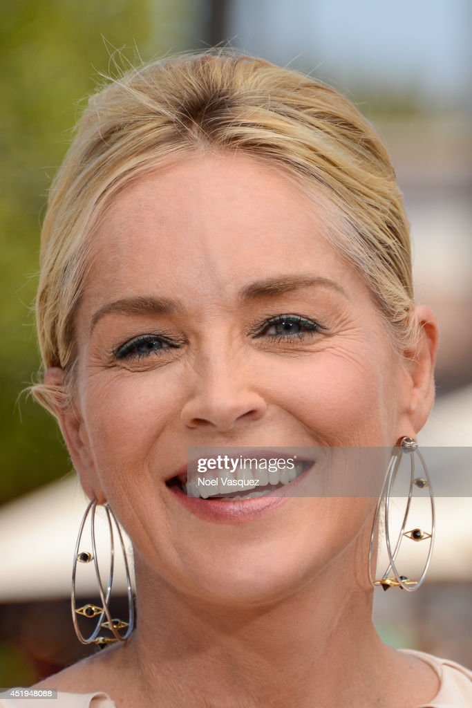 <a gi-track='captionPersonalityLinkClicked' href=/galleries/search?phrase=Sharon+Stone&family=editorial&specificpeople=156409 ng-click='$event.stopPropagation()'>Sharon Stone</a> visits 'Extra' at Universal Studios Hollywood on July 9, 2014 in Universal City, California.