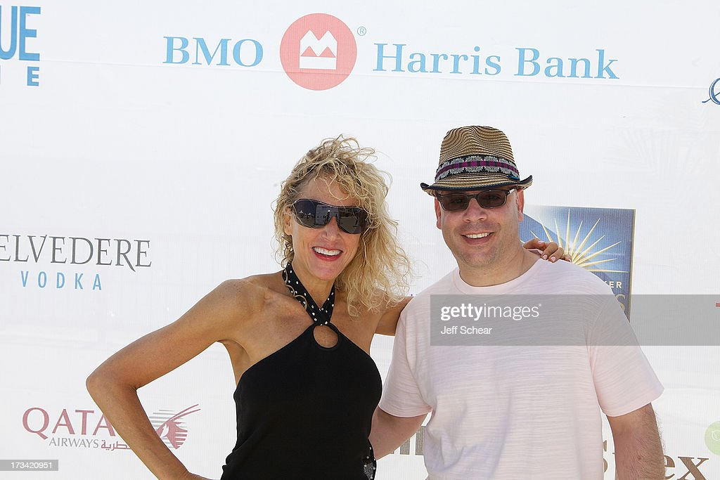 Sharon Uslan and Dan Uslan, President and Publisher at Michigan Avenue Magazine, attend Michigan Avenue Magazine and The Chicago Yacht Club host Ashore Thing presented by BMO Harris Bank on July 13, 2013 in Chicago, Illinois.