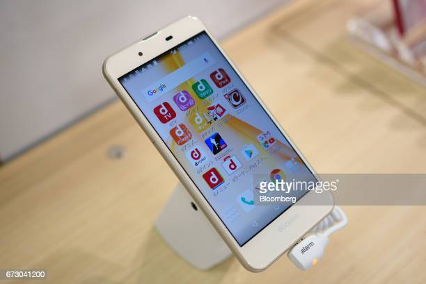 A Sharp Corp Aquos Ever smartphone sits on display at an NTT Docomo Inc store in Tokyo Japan on Monday April 24 2017 NTT Docomo one of the world's...