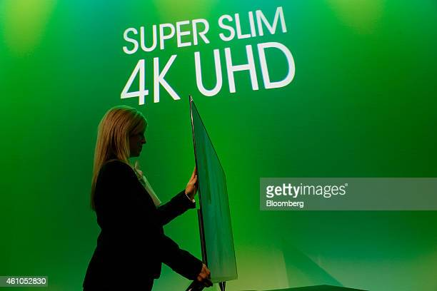 A Sharp Corp Super Slim 4k UHD television is displayed after a press conference during the 2015 Consumer Electronics Show in Las Vegas Nevada US on...