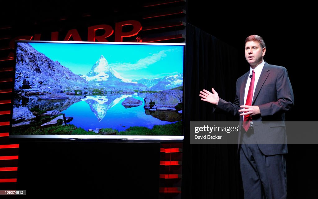 Sharp Electronics Vice President of Strategic Products Marketing Jim Sanduski unveils the Sharp Aquos Ultra HD television at a press event at the Mandalay Bay Convention Center for the 2013 International CES on January 7, 2013 in Las Vegas, Nevada. CES, the world's largest annual consumer technology trade show, runs from January 8-11 and is expected to feature 3,100 exhibitors showing off their latest products and services to about 150,000 attendees.