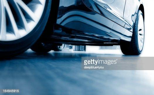 Sharp focus ground view of modern blue car