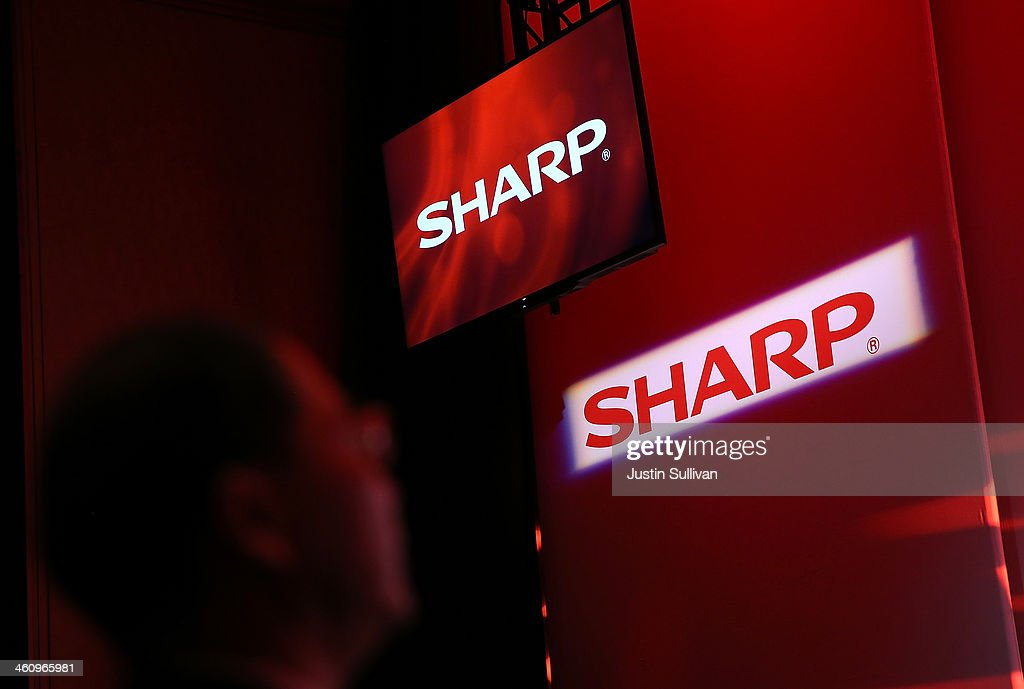 Sharp logos are displayed during a news converence at a press event at the Mandalay Bay Convention Center for the 2014 International CES on January 6...