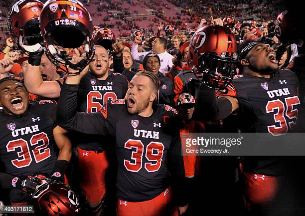 Sharrieff Shah Jr #32 Andy Phillips and Clarence Smith all of the Utah Utes celebrate their 3418 win over the Arizona State Sun Devils after their...
