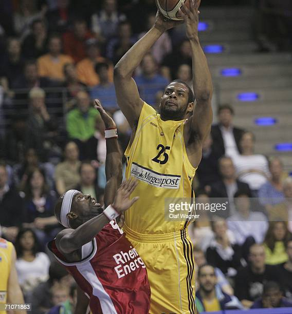 Sharrod Ford of Alba battle for the ball with Michael H Jordan of Koeln during game one of the Basketball Playoffs Final match between Alba Berlin...