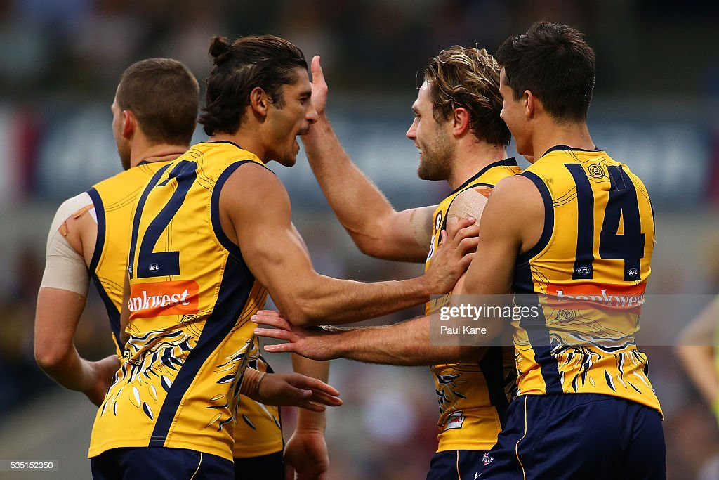 Sharrod Wellingham and Mark Hutchings of the Eagles celebrate a goal during the round 10 AFL match between the West Coast Eagles and the Gold Coast Suns at Domain Stadium on May 29, 2016 in Perth, Australia.