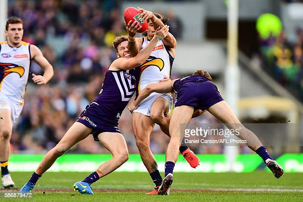 Sharrod Wellingham of the Eagles is tackled by Ed Langdon of the Dockers during the 2016 AFL Round 20 match between the Fremantle Dockers and the...