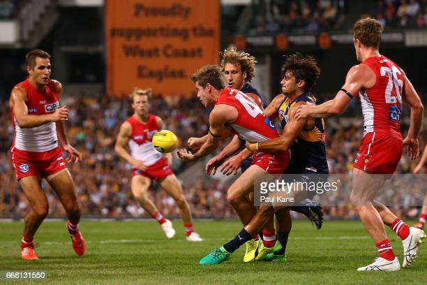 Sharrod Wellingham of the Eagles tackles Jake Lloyd of the Swans during the round four AFL match between the West Coast Eagles and the Sydney Swans...