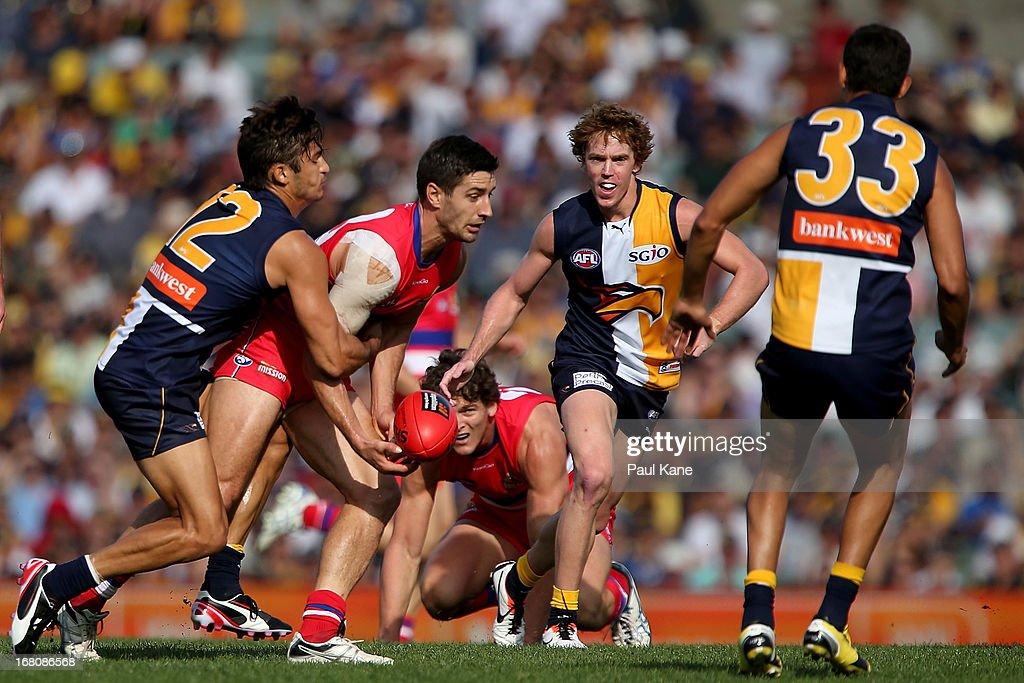 Sharrod Wellingham of the Eagles tackles Nick Lower of the Bulldogs during the round six AFL match between the West Coast Eagles and the Western Bulldogs at Patersons Stadium on May 5, 2013 in Perth, Australia.