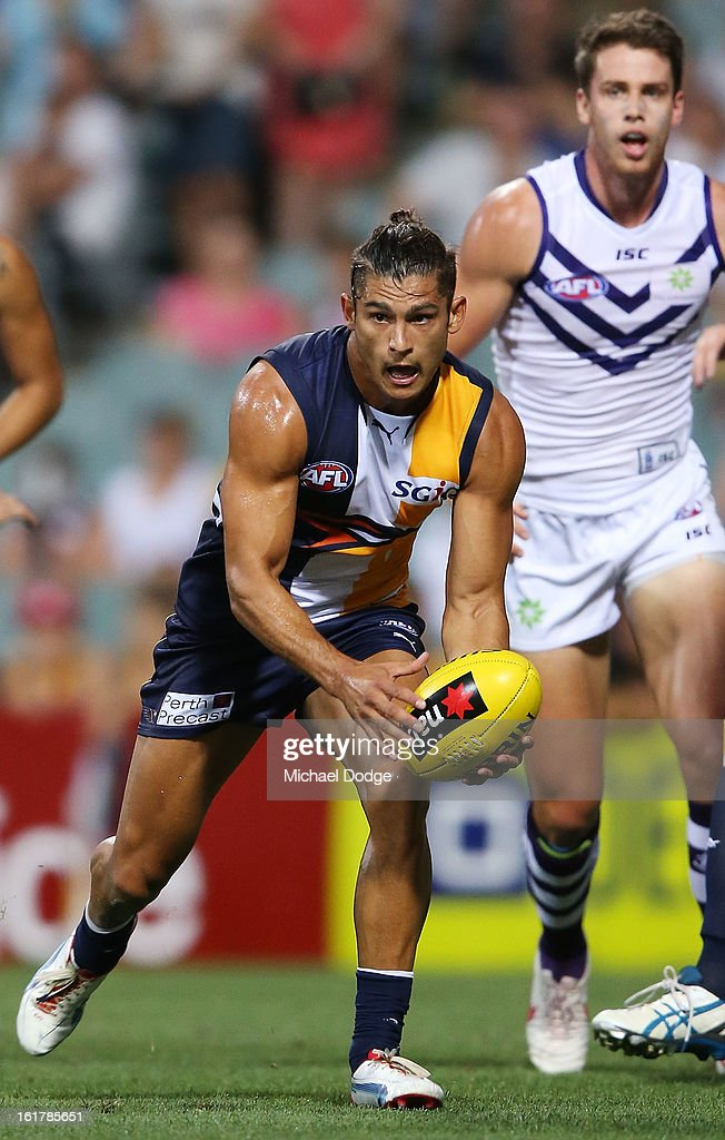 Sharrod Wellingham of the West Coast Eagles runs with the ball during the round one NAB Cup match between the West Coast Eagles and the Fremantle Dockers at Patersons Stadium on February 16, 2013 in Perth, Australia.